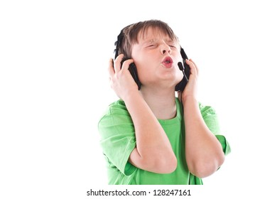 Boy listening to music with headphones on white background