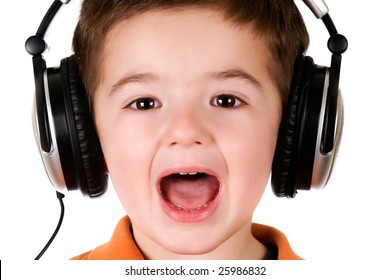 Boy listening to music on headphones. Isolated on white.