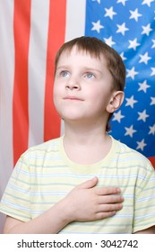 A boy listening national anthem on 4th of July