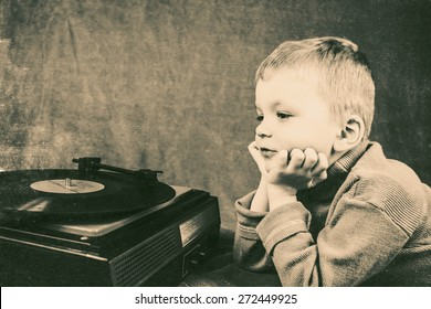 boy listening to retro music player