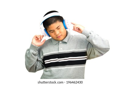 Boy listens music by earphone to the music, on white background.