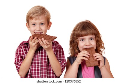 boy and little girl eating chocolate