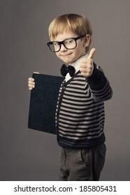 boy little smart child in glasses showing blank book, card certificate, school education advertisement