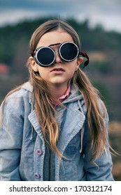 boy with long hair with goggles