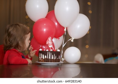 Boy with long hair has his 4th birthday