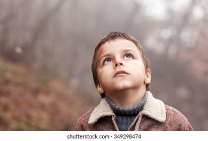 boy looking up