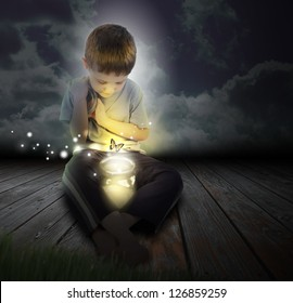 A boy is looking at a glowing bug firefly coming out of a jar with a butterfly at night for an imagination or hobby concept.