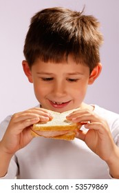 boy looking at his sandwich, selective focus on hands and sandwich