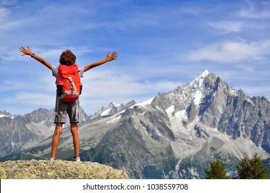 Boy looking at mountains, Chamonix Mont Blanc, France
