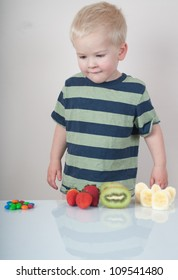 boy looking at selection of snacks gazing at sweets