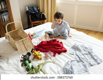 A boy looking at superhero costume in a bedroom
