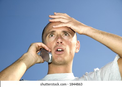 Boy looking surprised on the phone