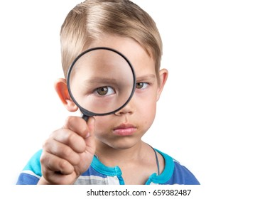 boy looking through a magnifier isolated on white background