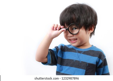 Boy looking through magnifying glass isolated on white background