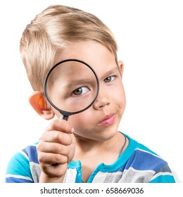 boy looking through a magnifying glass isolated on white background