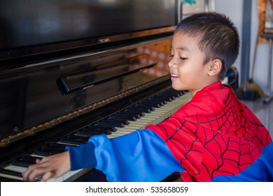 Boy looking very excited about taking piano lessons