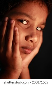A boy looks  in a depressed mood. Focus on eyes with shallow depth of filed