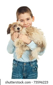 Boy loving and bonding his puppy fluffy dog over white background