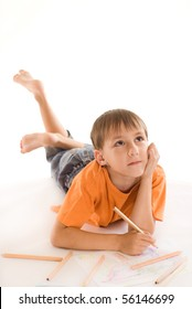boy lying on the floor and draw