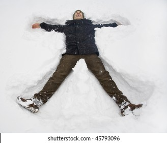 boy lying on snow elevated view portrait