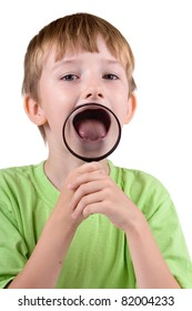 Boy with magnifying glass isolated on a white background