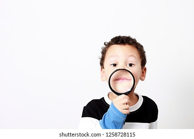 boy with magnifying glass ready to explore stock photo