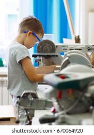 A boy makes a car model