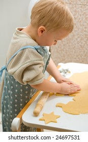 Boy makes cookies in the kitchen