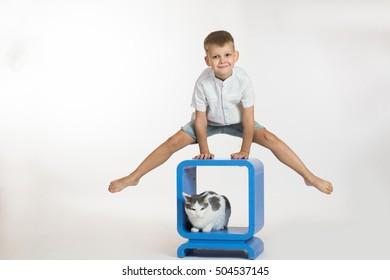 Boy makes gymnastic exercises