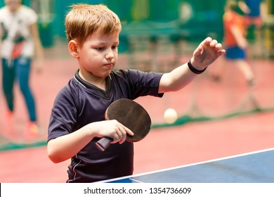 the boy makes a pitch in table tennis, table tennis ball in the air. ping pong