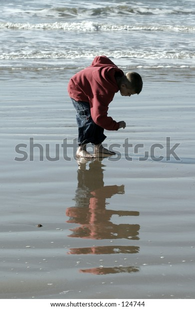 Boy making a find on the beach