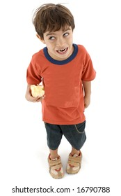 Boy making a funny face and holding a bite apple .