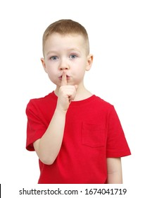 Boy making silence gesture with finger on his lips, keeping some secret, child mystery. Shh, be quiet