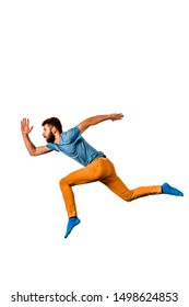 Boy man teen dancing and jumping isolated on white background in studio