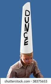 Boy mannequin wearing dunce cap against blue background