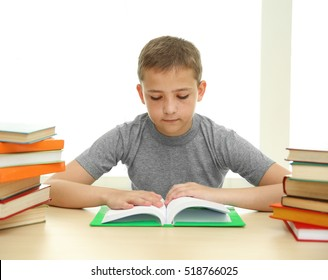 Boy with many books at school