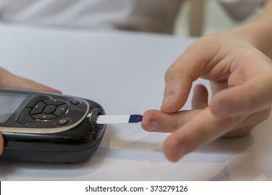 Boy measure glucose or blood suger level