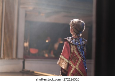 boy in medieval costume acting
