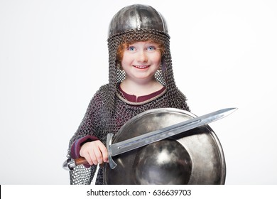 boy medieval warrior, baby in knight costume, boy in a knightly helmet,  sword boy isolated on a white background, historical suit, soldier holding a sword, curly hair, knight, warrior, chain armor