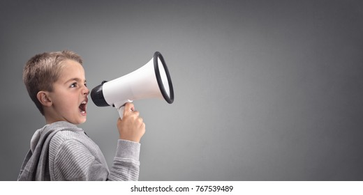 Boy with megaphone making an announcement with copy space