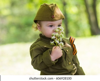 Boy in military uniform on holiday day of victory, May 9, Russia