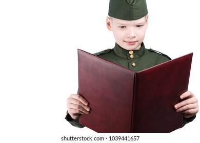boy in military uniform reads a folder with an oath