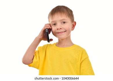 A boy with a mobile phone. A yellow T-shirt. A child's portrait on a white background.