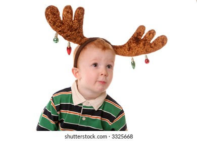 boy with moose christmas antlers