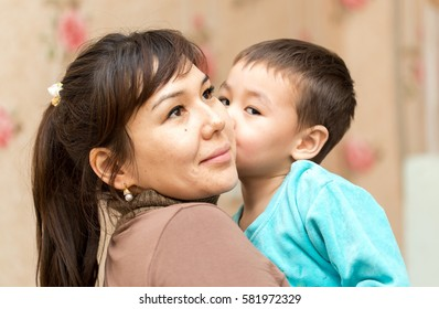 boy with mother cuddling
