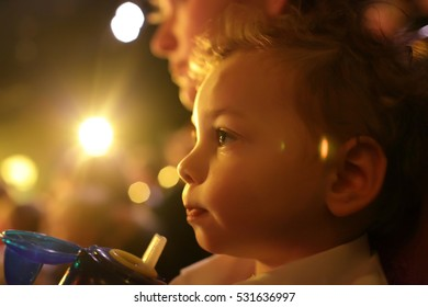 Boy with mother enjoying time in the theater