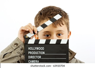 Boy with movie clapper board over white