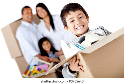 Boy moving with his family and holding a box with toys - isolated over a white background