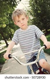 Boy on a bike with a scraped knee