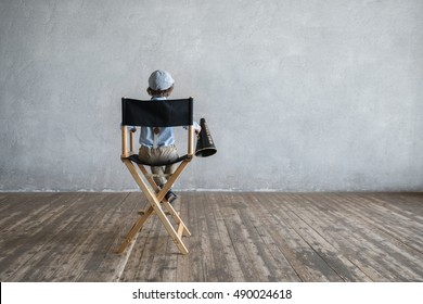 Boy on the director's chair